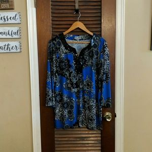 Rich blue top with a unique lace and animal print